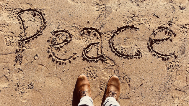 beach_writing_peace_boots