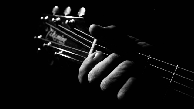 electric_guitar_hand_bw_closeup
