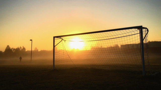 football_goalposts_sunset