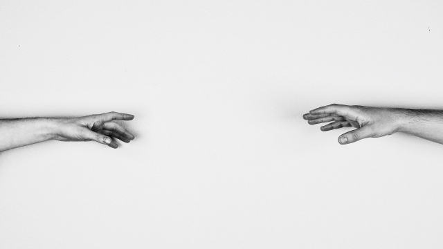 hands_reaching_towards_each_other