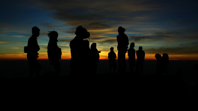 people_silhouettes_hill_sky