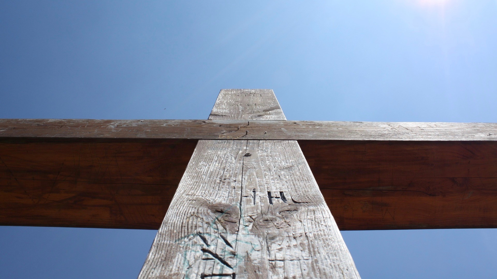 Looking upwards at a wooden cross